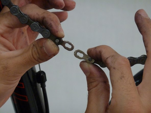 To reassemble the chain bring both ends of the chain together so that the pins on each one lineup.