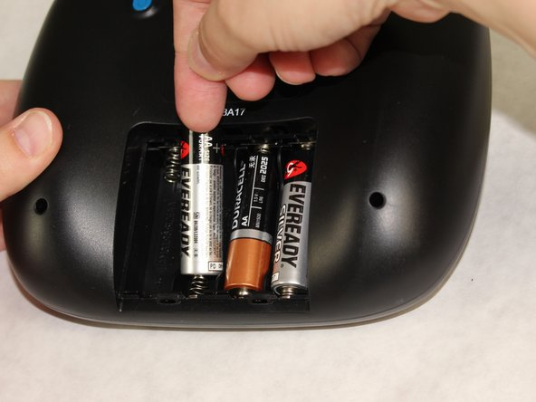 Remove the AA batteries using the positive side to lift the batteries out of remote.