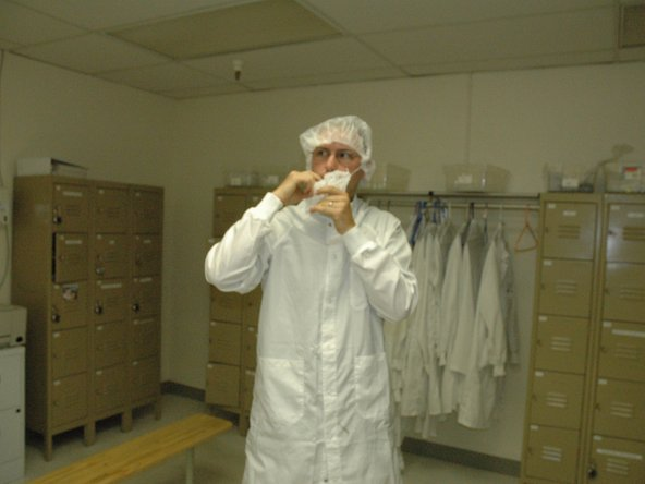 Our illustrious leader preparing to enter a cleanroom for some silicon surgery on the original iPhone.