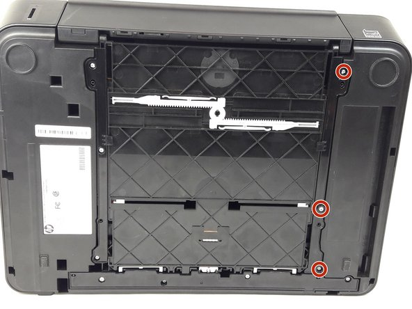 Locate the three 13mm TR10 Torx Security screws on the right side panel.