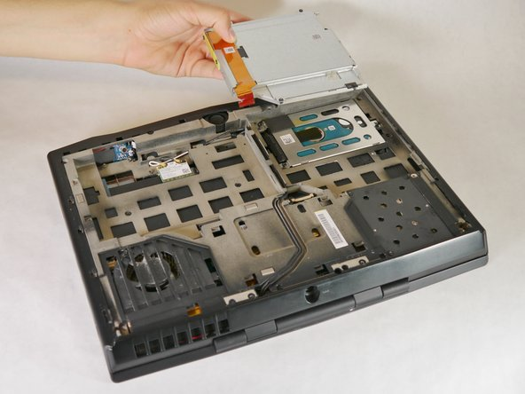 Lift the optical drive up and out of the laptop and set it aside.