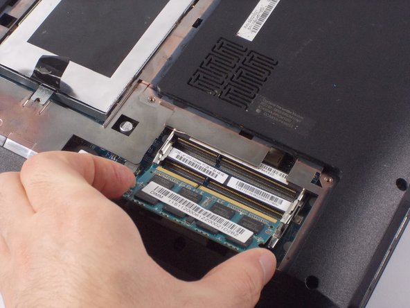 Remove RAM by carefully pulling it away from its socket.