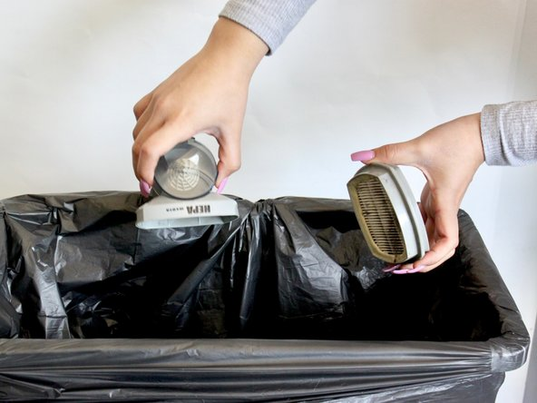 Hold the HEPA dust filter over trash bin and gently shake to clean. Use hands to rub off dirt/dust if necessary.