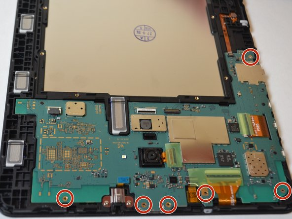Remove the six 4mm Phillips #000 screws from the motherboard.