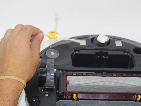 Lift the side brush from the device.