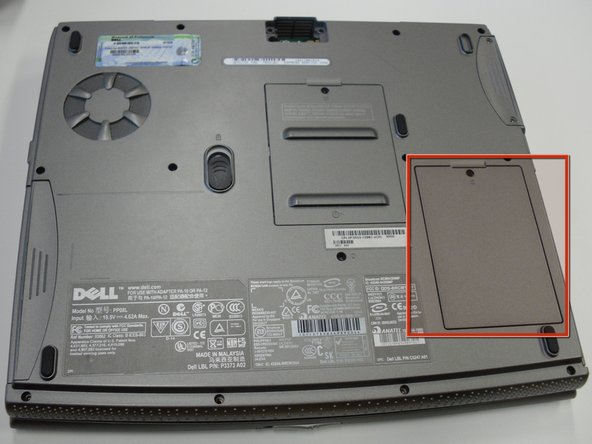 Image 1/3: Unscrew the single screw holding the cover in place.