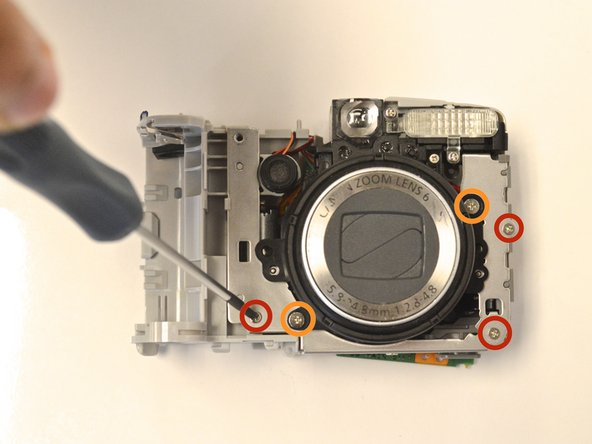 Use the screwdriver to remove the three 3 mm Phillips screws from the lens metal frame.
