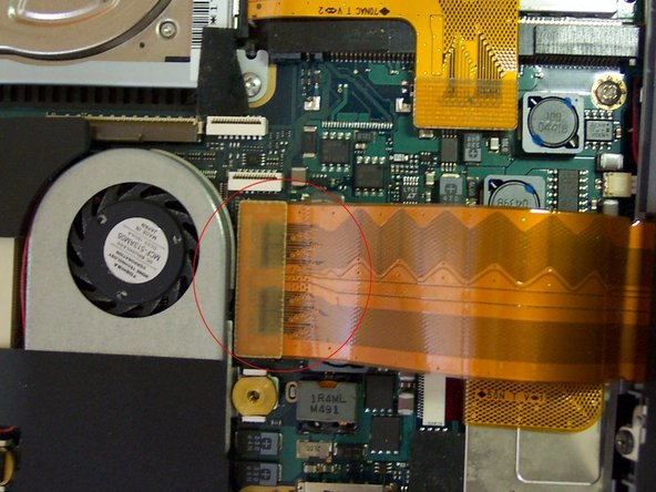 Image 2/2: Disconnect 3 ribbons and pull top carefully towards the left side. Remove ribbon from the motherboard.
