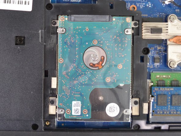 After removing back panel, the hard-drive can be found underneath.