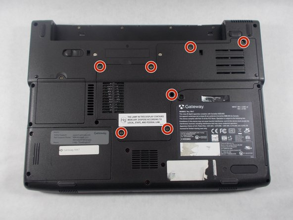Remove the following screws securing the plastic panel from the bottom of the laptop: