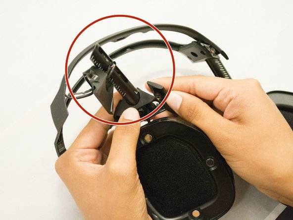 Use your hand to remove the headband adjuster.
