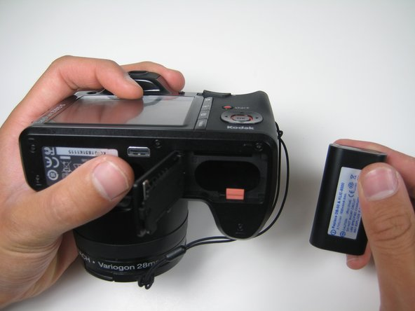Once the battery has popped out of the compartment, simply pull it out of the camera.