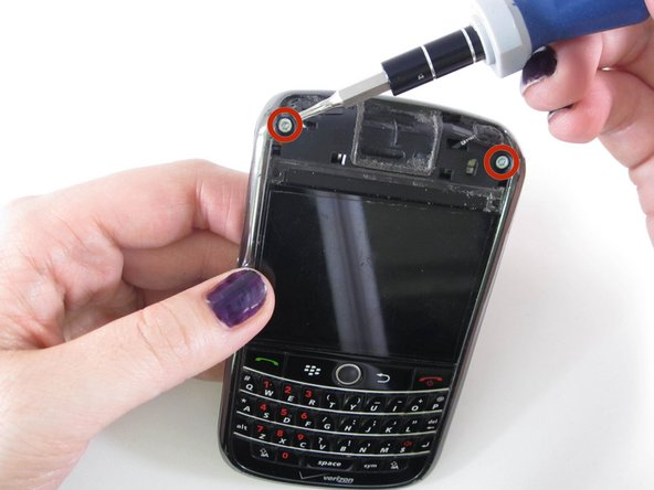 Use the T6 Torx screwdriver to remove the two 8.00mm screws from the top of the phone.
