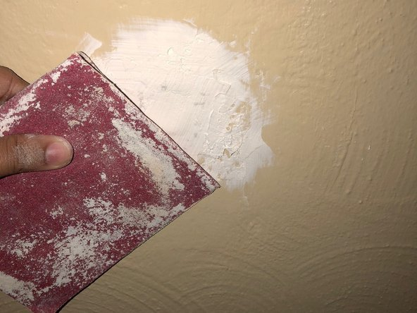 Once compound is dry, use sandpaper to smooth out the entire surface of the dried compound.
