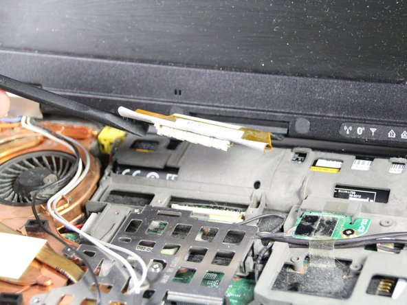 Use the spudger to detach the screen's ribbon cable.