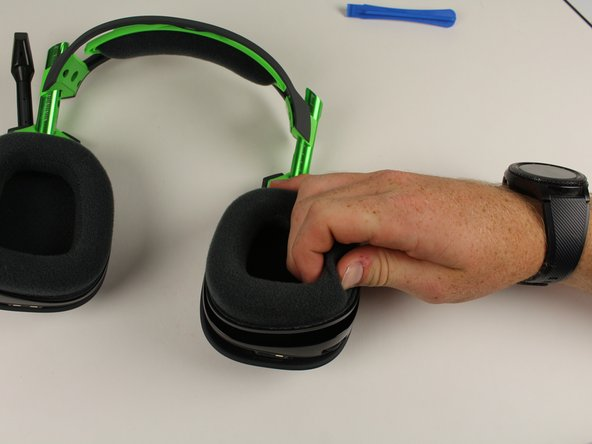 Remove the magnetic ear pads by gently pulling up away from the head set.