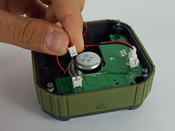 Remove the speaker wire by carefully pulling the plug out of the socket on the motherboard.