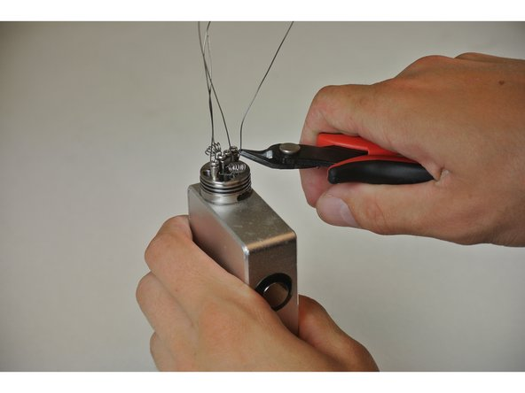 Image 1/2: '''CAUTION:''' Cutting the wires may send the end pieces flying, be careful when cutting.