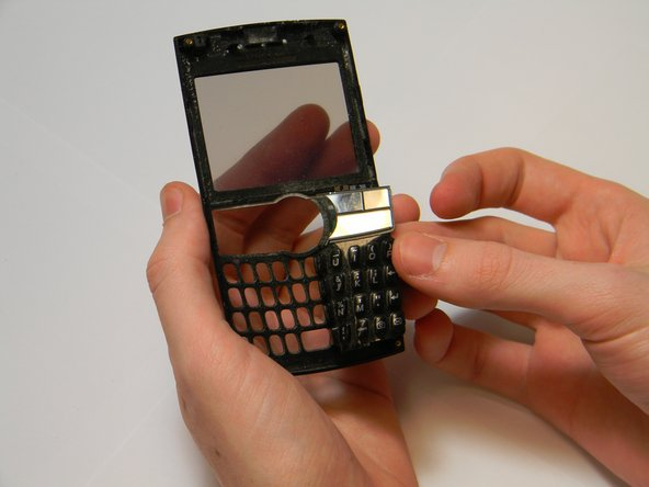 Peel back the rubber keypad from the front casing.