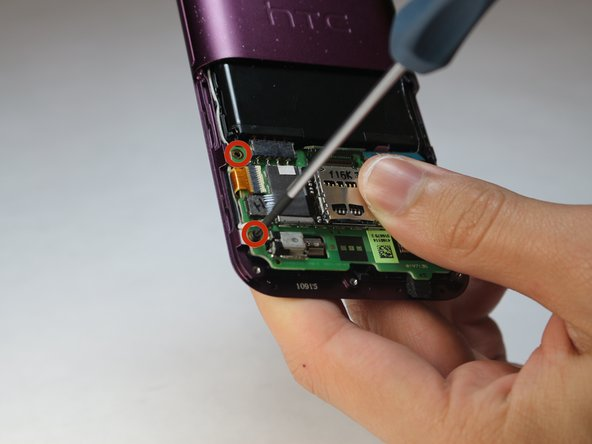 Using a Phillips #00 screwdriver, unscrew the four screws in each corner of the motherboard.