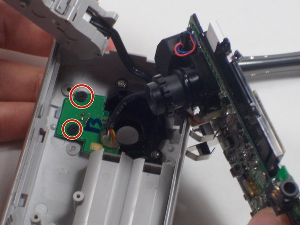 Remove the two 1mm screws and separate the circuit board and camera from the plastic casing.