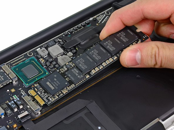 Image 2/2: When reinstalling the SSD, be sure it is properly seated before reinstalling its retaining screw.