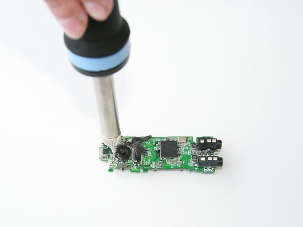 Using the soldering tool, remove the joystick control.