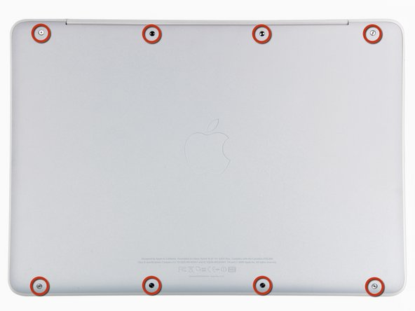 Image 1/1: Remove the eight 4 mm Phillips screws securing the lower case to the MacBook.