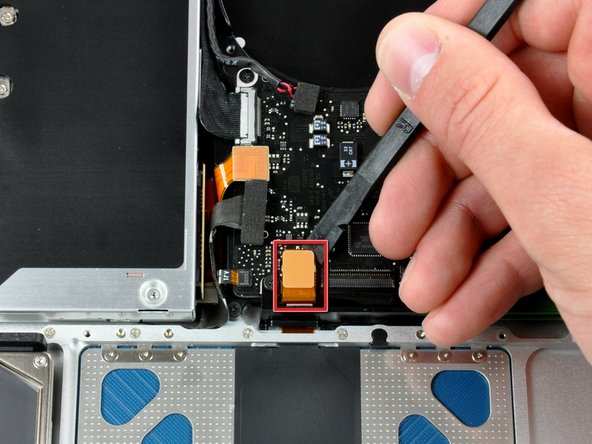 Use the flat end of a spudger to pry the trackpad connector straight up off the logic board.
