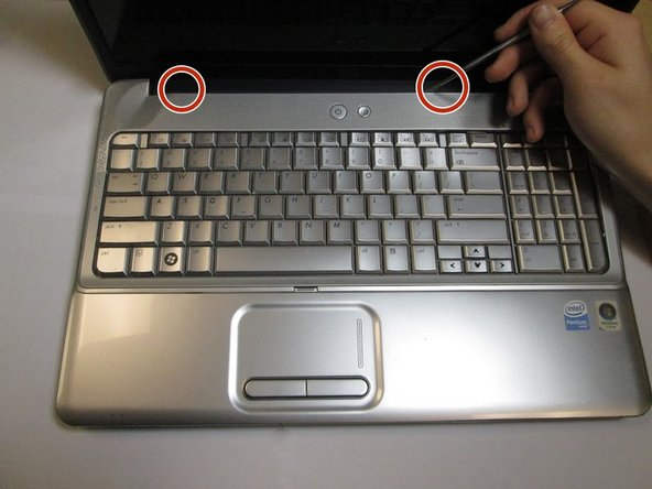 After the screws from battery house are removed, open the laptop to remove the keyboard frame.
