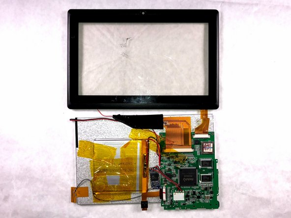 Once all clips are released gently open and separate the front plastic display from the LCD and place the LCD face down.