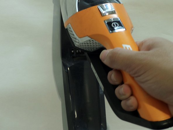 With great force, remove the handheld vacuum from the entire unit.