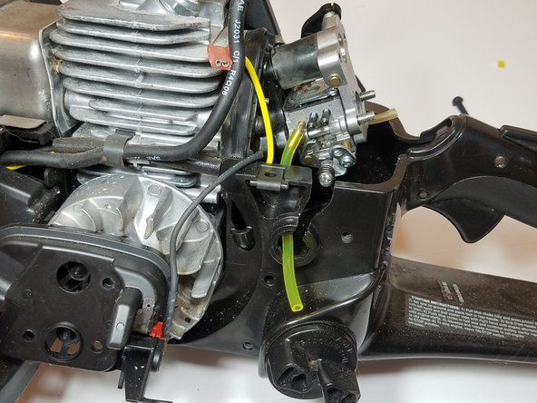 If the primer suction line was damaged, slide the carburetor back onto the mounting bolts