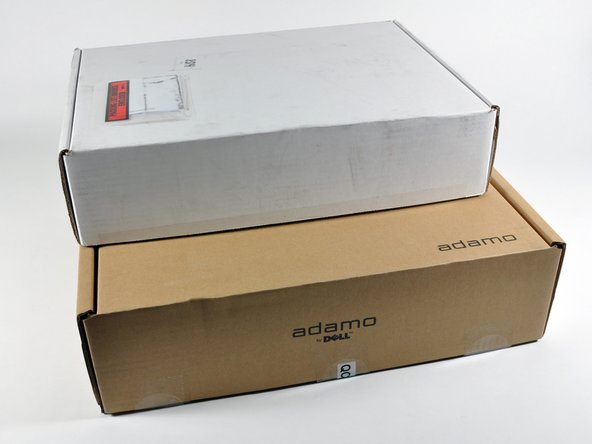 Image 2/2: The shipping box is substantially larger than that of the MacBook Air (white box), but the two machines are nearly identical in size.