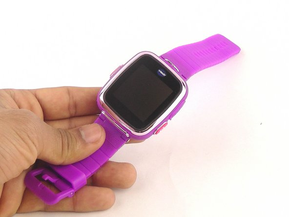 Flip the watch so that the screen faces upward.