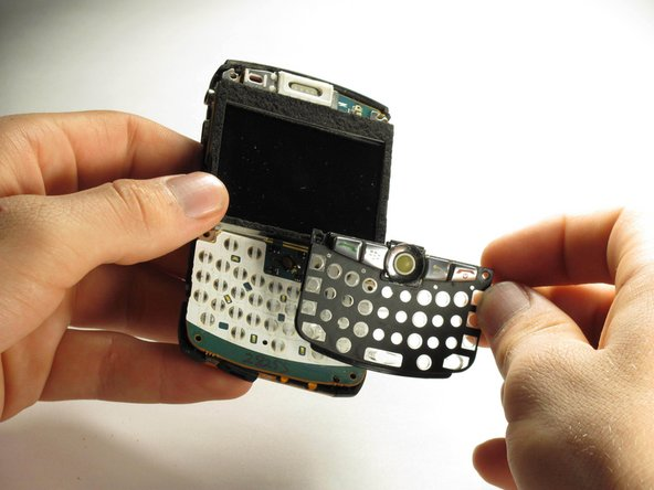 When all four screws are removed, the keyboard frame, screen housing, screen, and back casing can be separated.