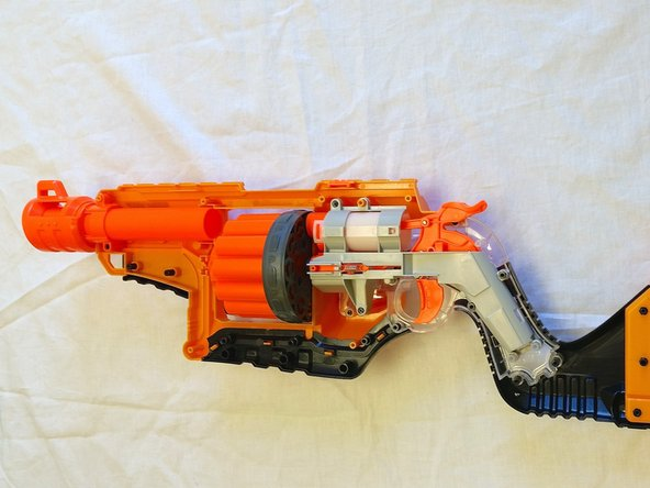 Carefully reassemble the NERF Lawbringer in the same order you took it apart. Carefully reattach the three screws that seal the air chamber.