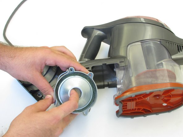 Pull the fan out of the compartment by pulling gently on the metal ring.