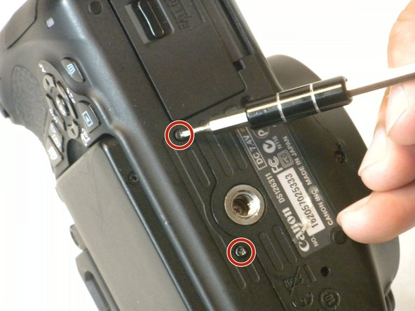 Remove four 3 mm Phillips #000 screws on the bottom of the camera.