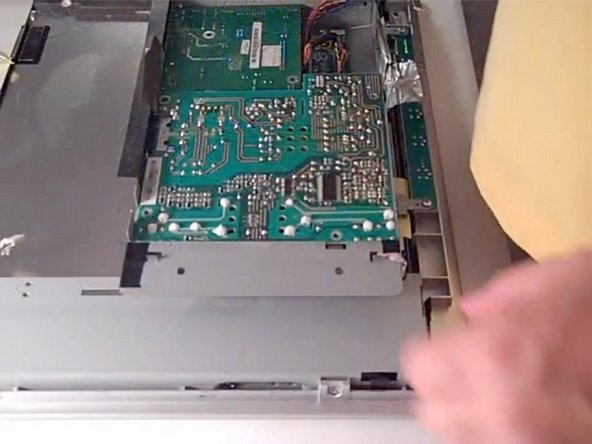 Image 3/3: Locate the power unit and remove any screws to access it.