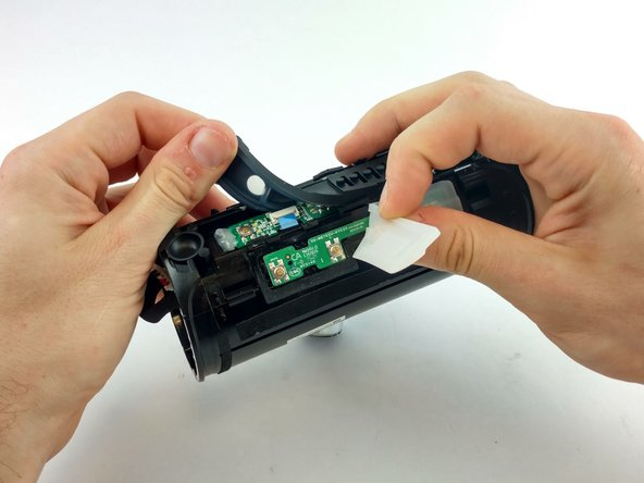 Remove the silicone button cover to expose the power chip.