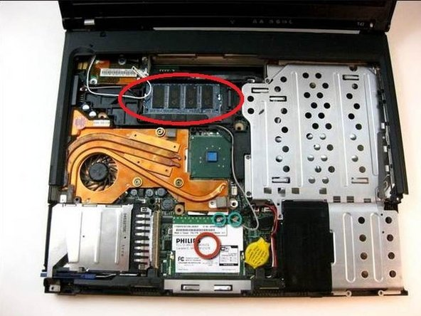 Follow the previously noted guides to replace the memory module under the memory cover.