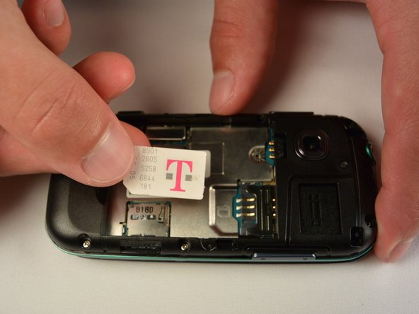 Image 3/3: Follow the visual on the bottom of the SIM card slot to put the SIM card back in the correct orientation.
