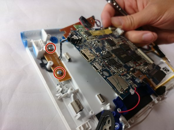 With all of these components out of their place, lift up the motherboard to reveal one more bronze plate.