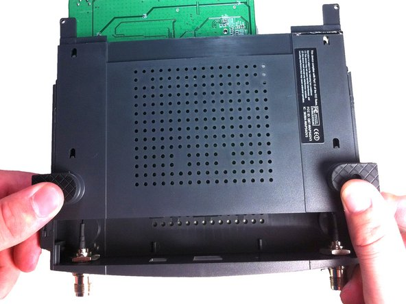 Now slide the bottom panel forward and remove it so the top casing is isolated from the bottom casing and motherboard.