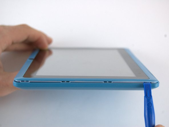 Use the plastic opening tool to pry the back off the tablet. Work your way around the edges. Once you have one side open you can slowly unsnap the rest of the case and use the tool as needed.