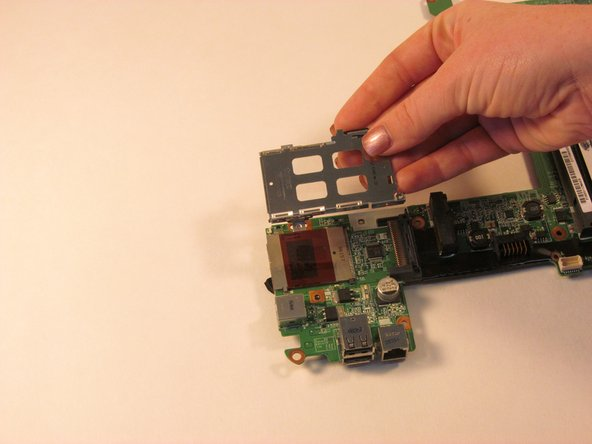 Gently remove the bezel from the system board.