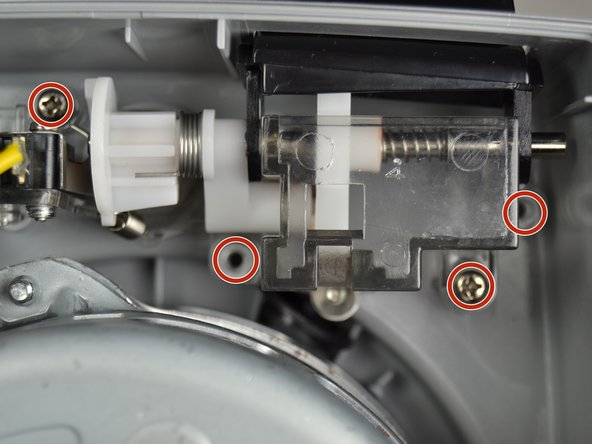 Remove the four screws (circled in red) holding the switch down.