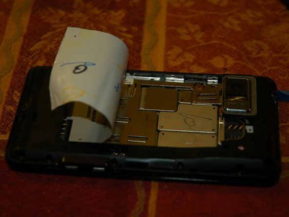 Peel back label half way, far enough to expose shields from the motherboard.