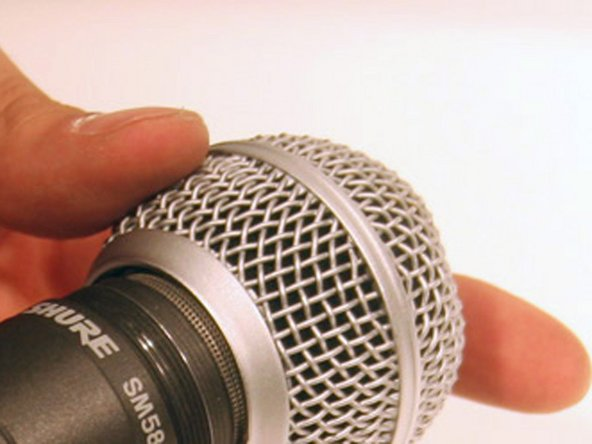 Slide the grille off the top of the microphone once it is all the way loosened.
